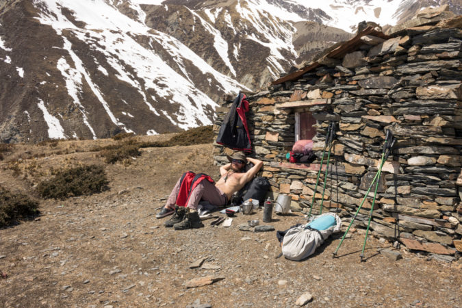 sunbathing nepal mountain hut